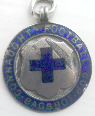 Silver medal with enamelled shield and wording