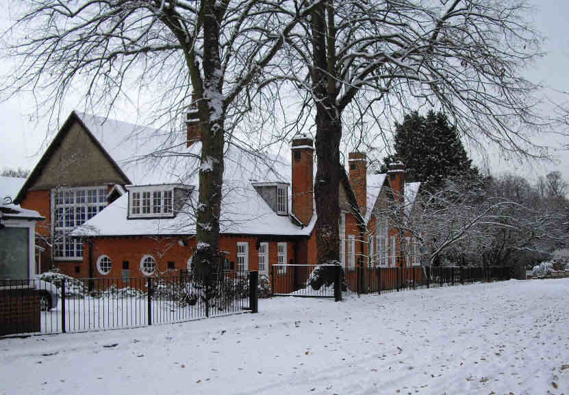redbrick school building in snow