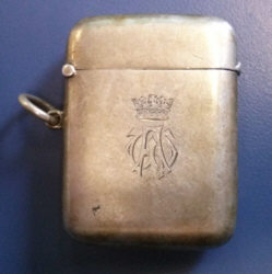 rectangula rsilver container with a monogram